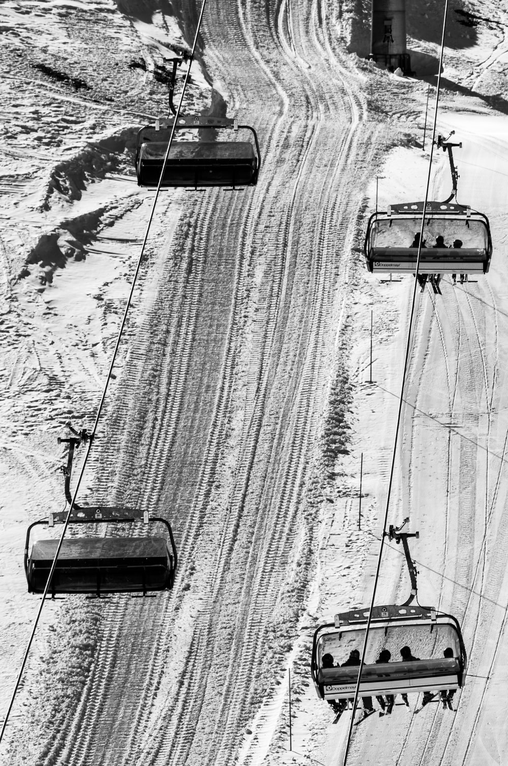 grayscale photo of bird's eye view of cable trains