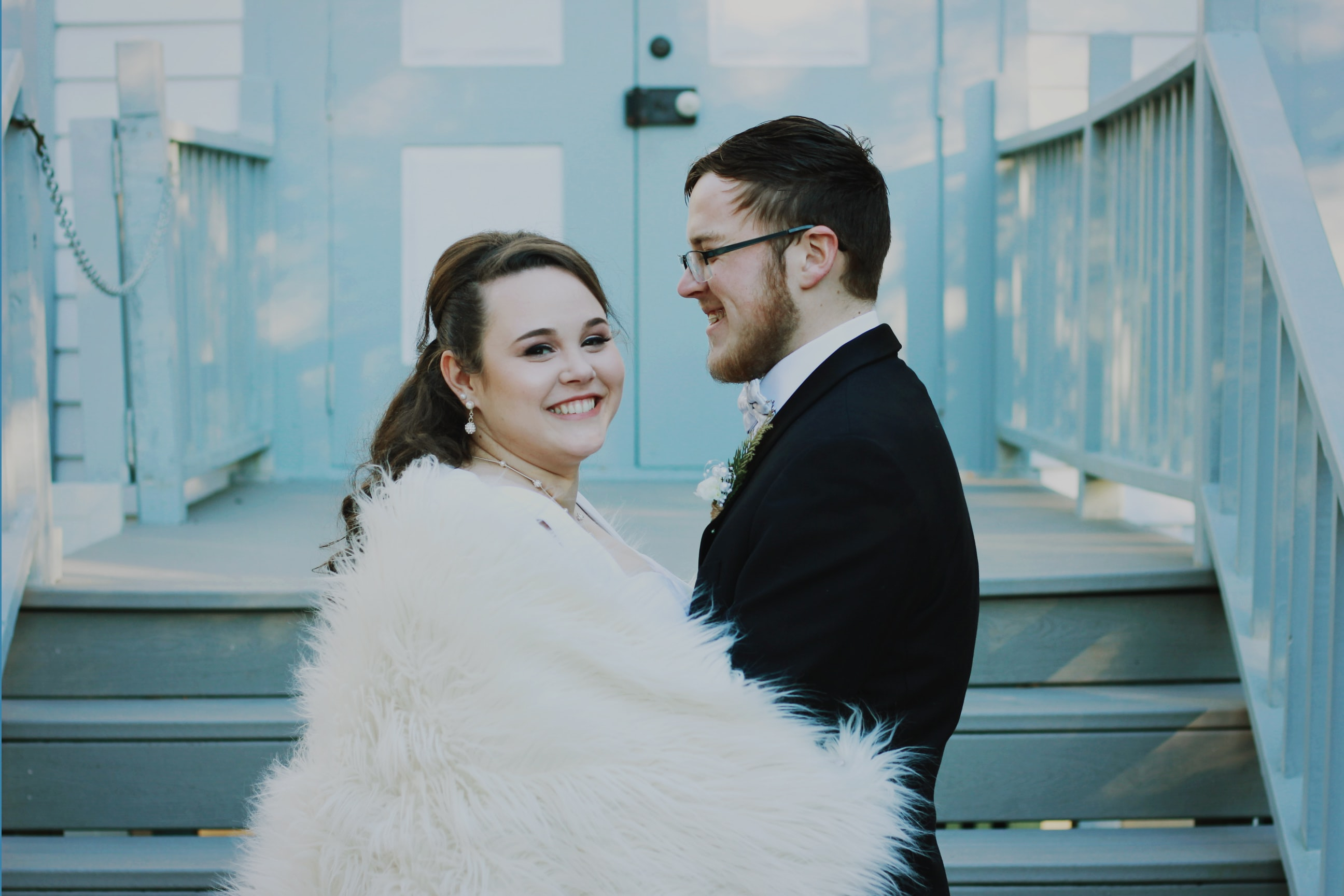 wedding couple near stair during daytime photography