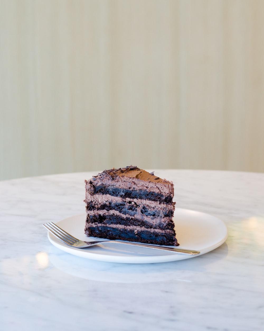 sliced chocolate cake beside fork on plate