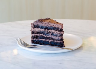 sliced chocolate cake beside fork on plate