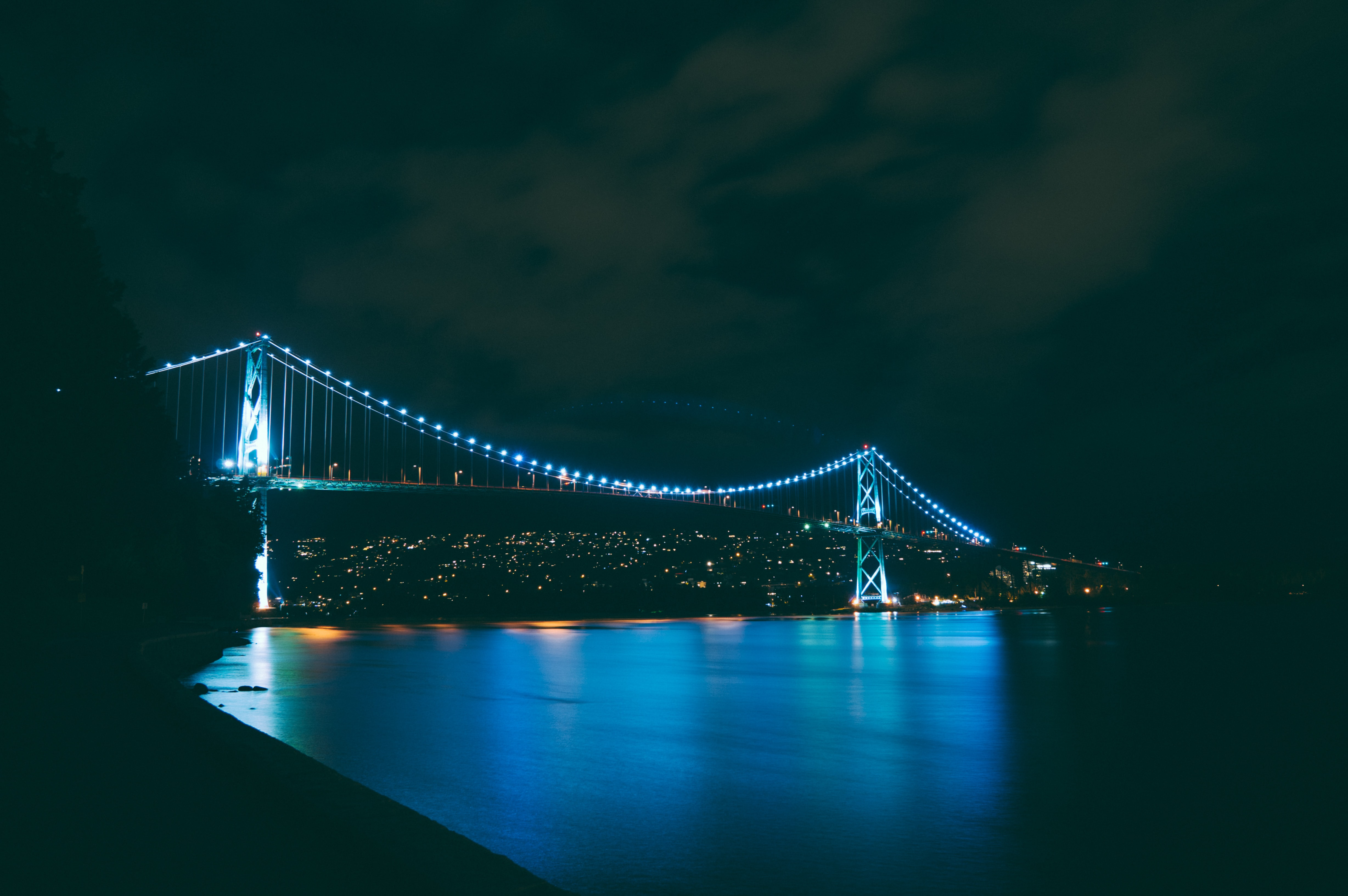 bridge with turned on blue string lights during nighttime