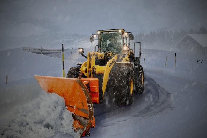 yellow and orange snow plouh