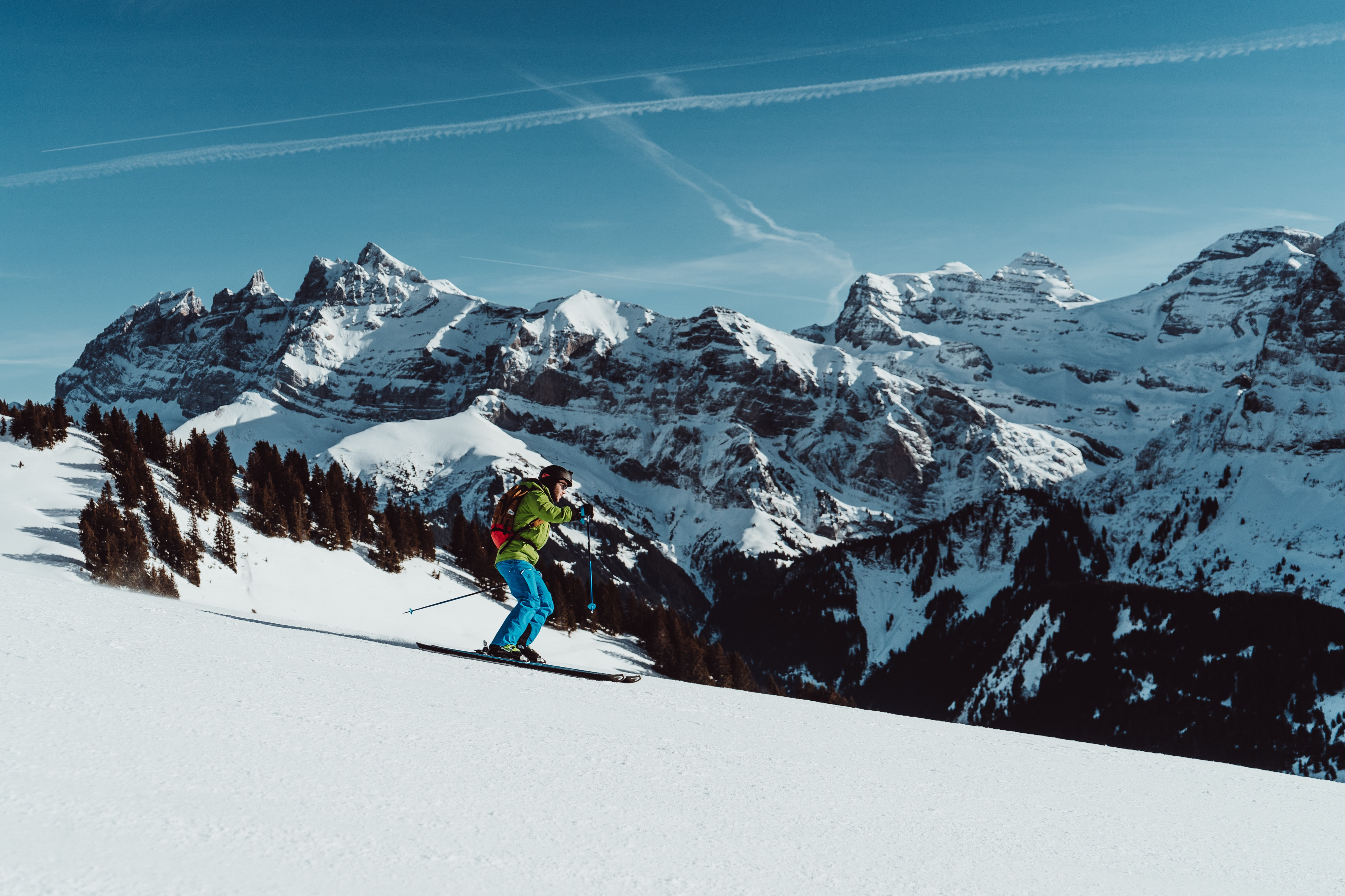 person snow skiing near snow capped mountain
