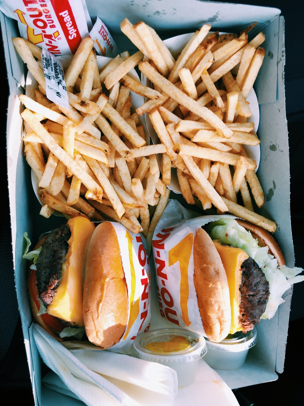 burgers and fries inside box |  Foreign Fast-Food Franchisee