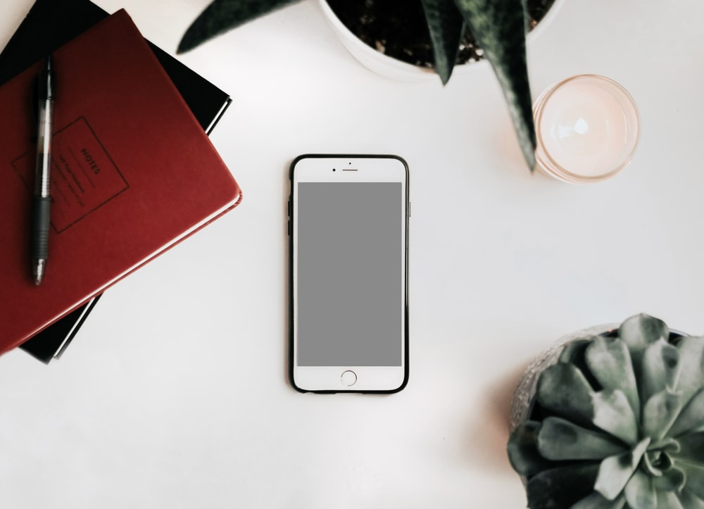 photo of iPhone on white surface