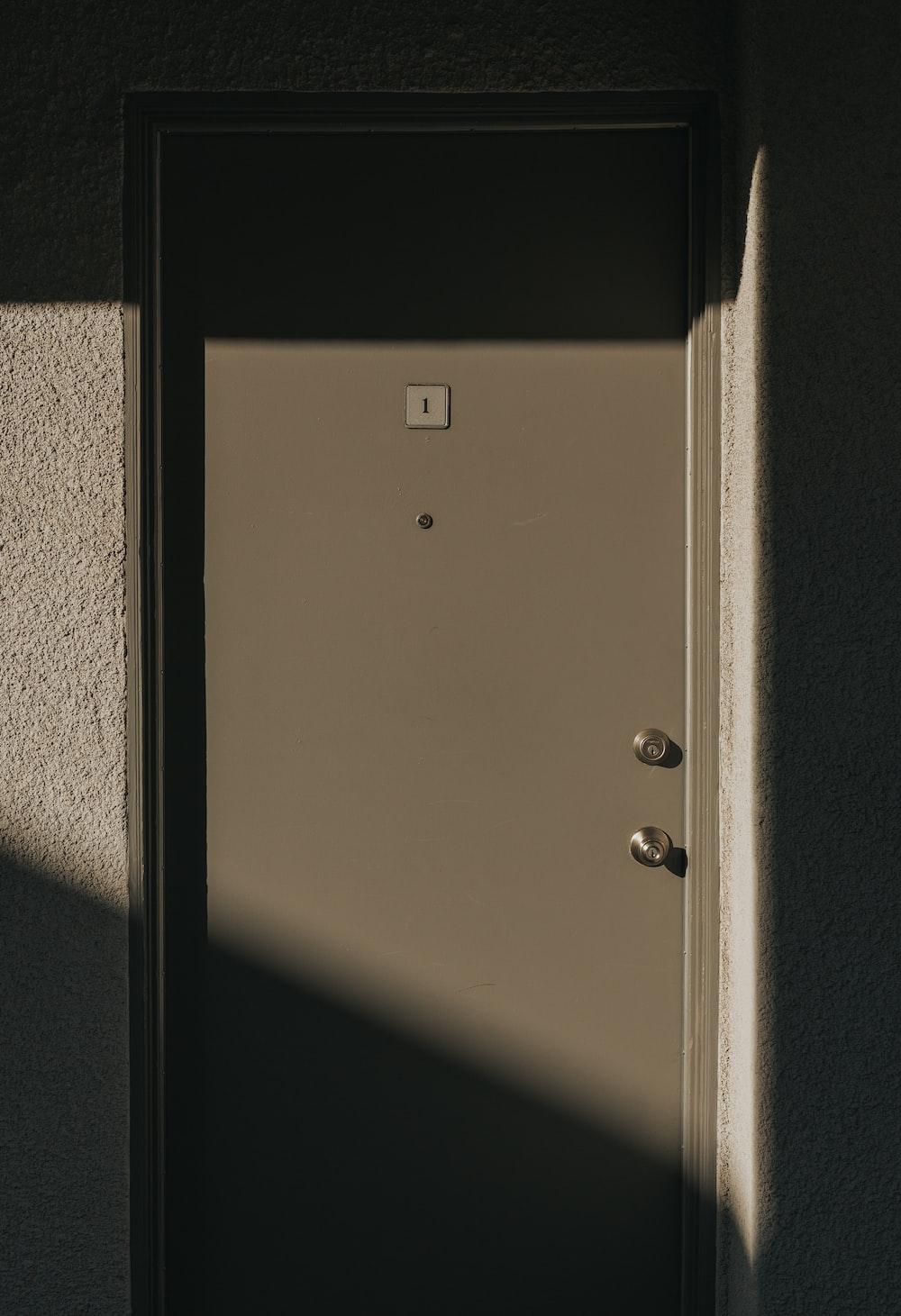 closed gray wooden door