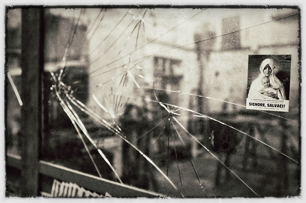 grayscale photo of broken mirror