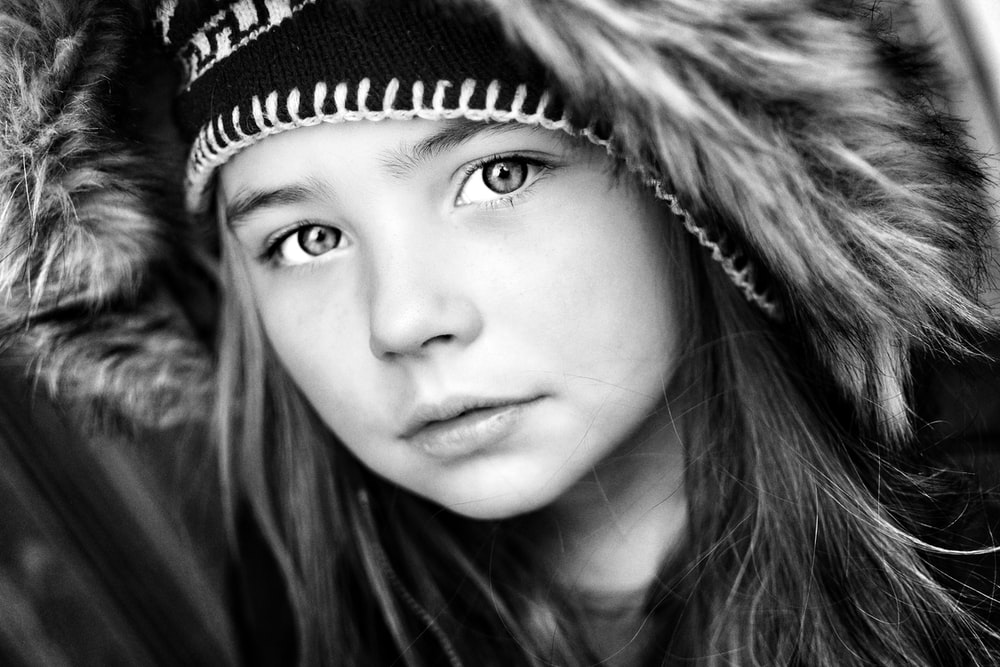 grayscale photography of girl wearing hooded top