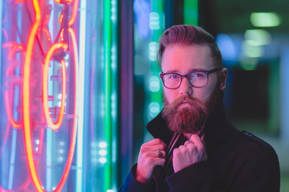 man holding black coat
