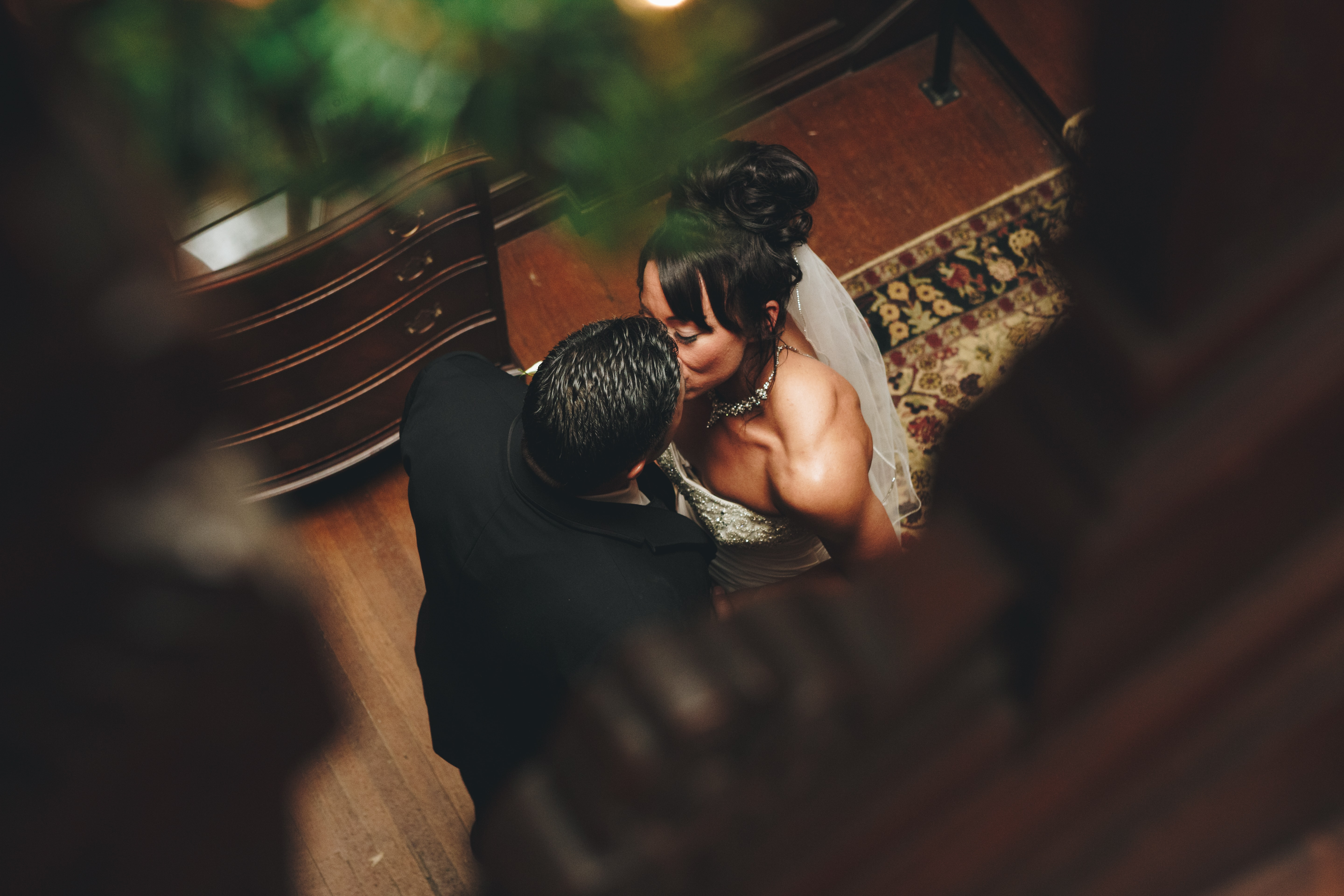 couple kissing near brown wooden chest