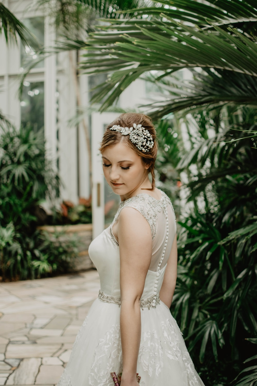 woman wearing white wedding gown near tree
