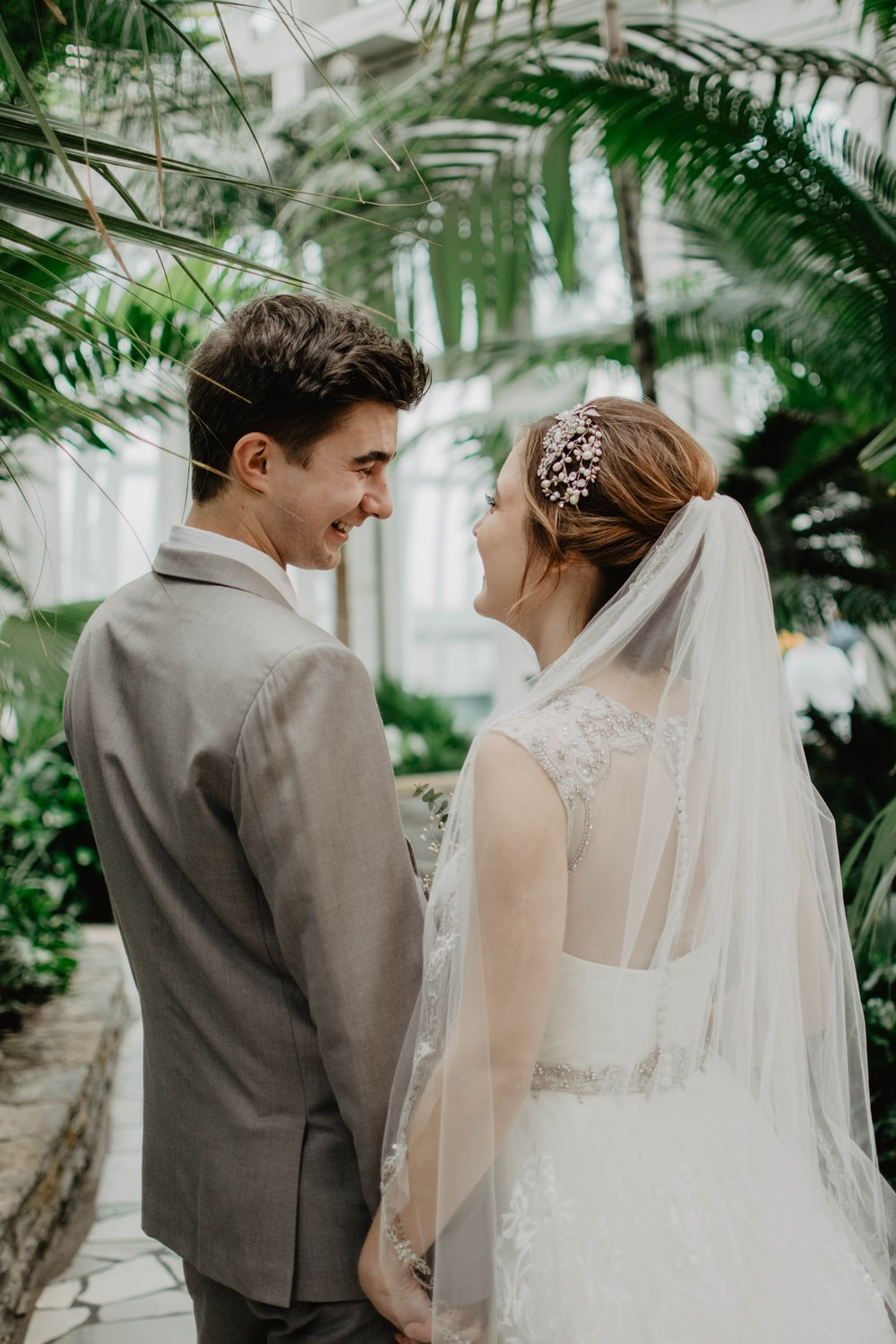 bride and groom surrounded by plants
