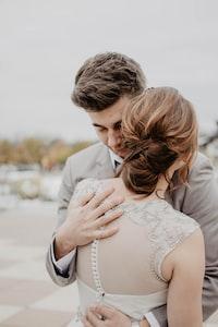 couple hugging under gray sky