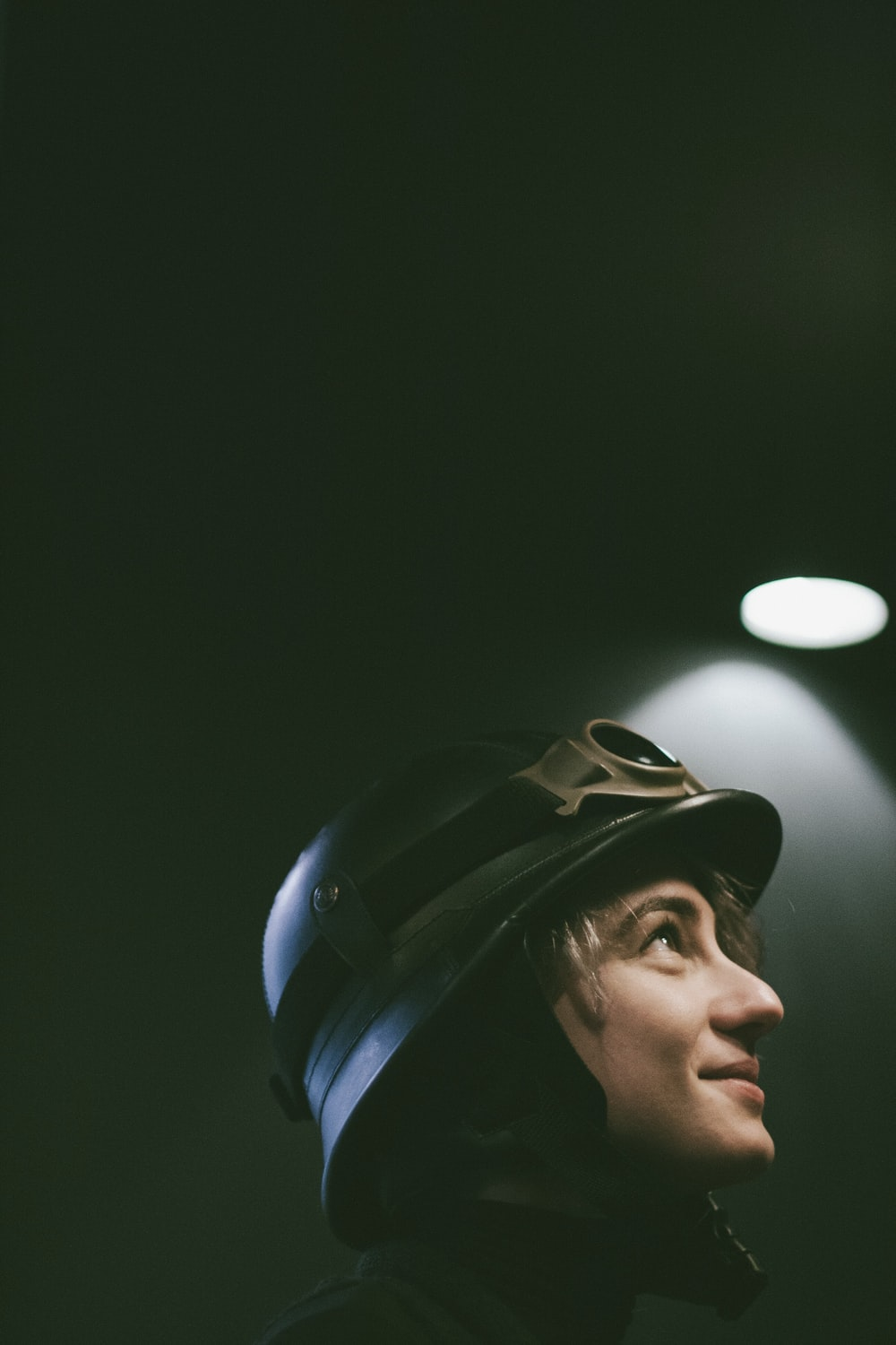 person wearing black hard hat looking up