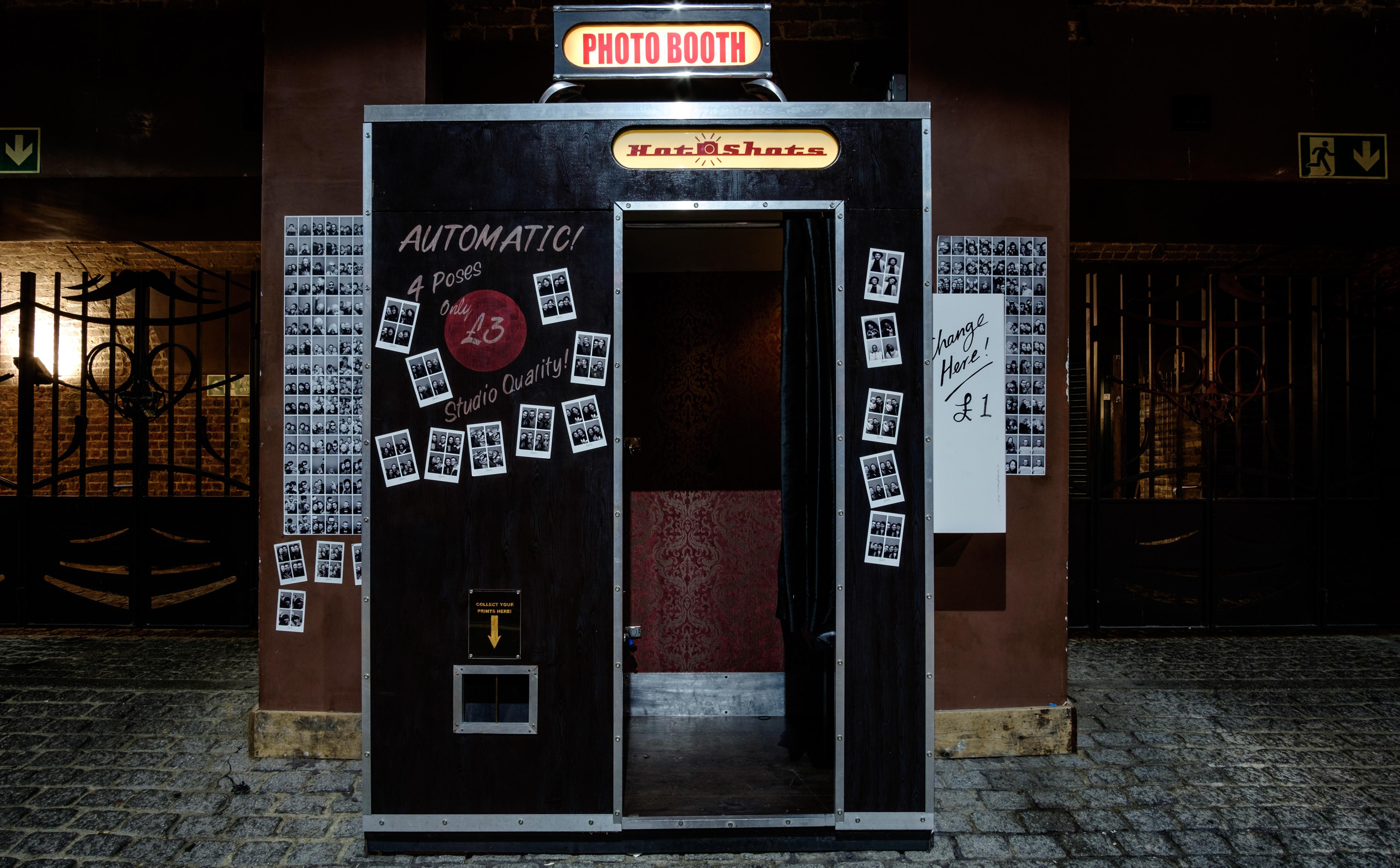 black photo booth with opened door