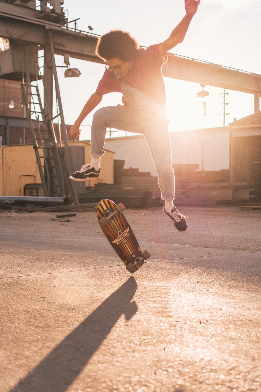 man skate boarding during daytime
