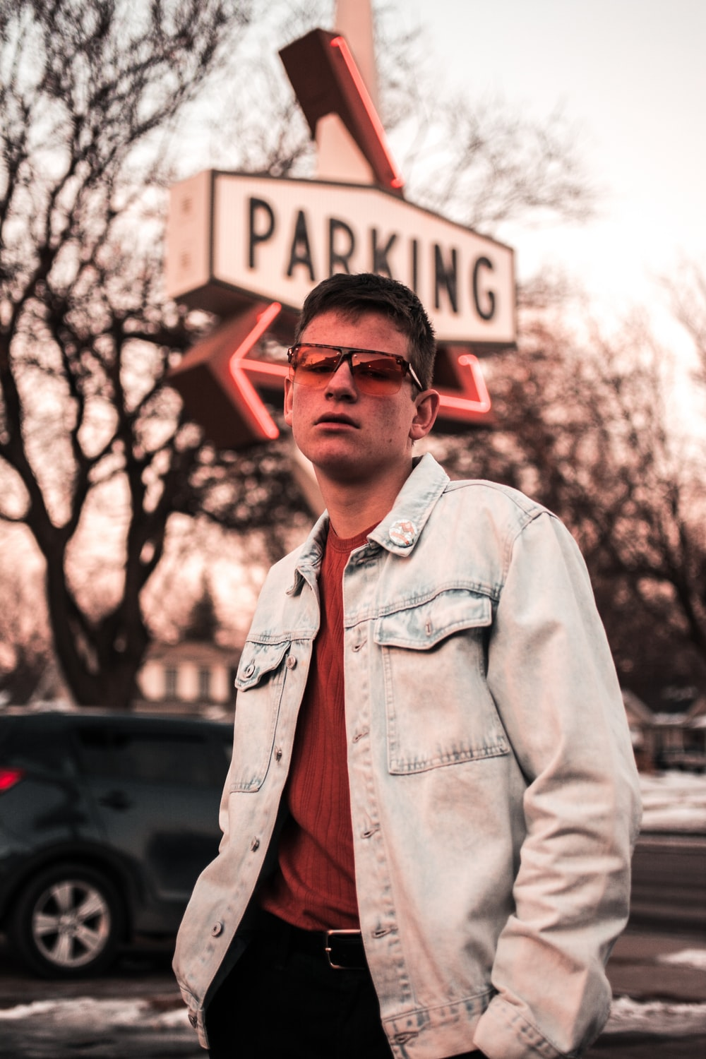 man standing in front of parking signage