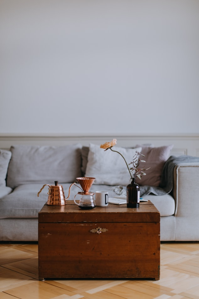 living room table with copper kettle
