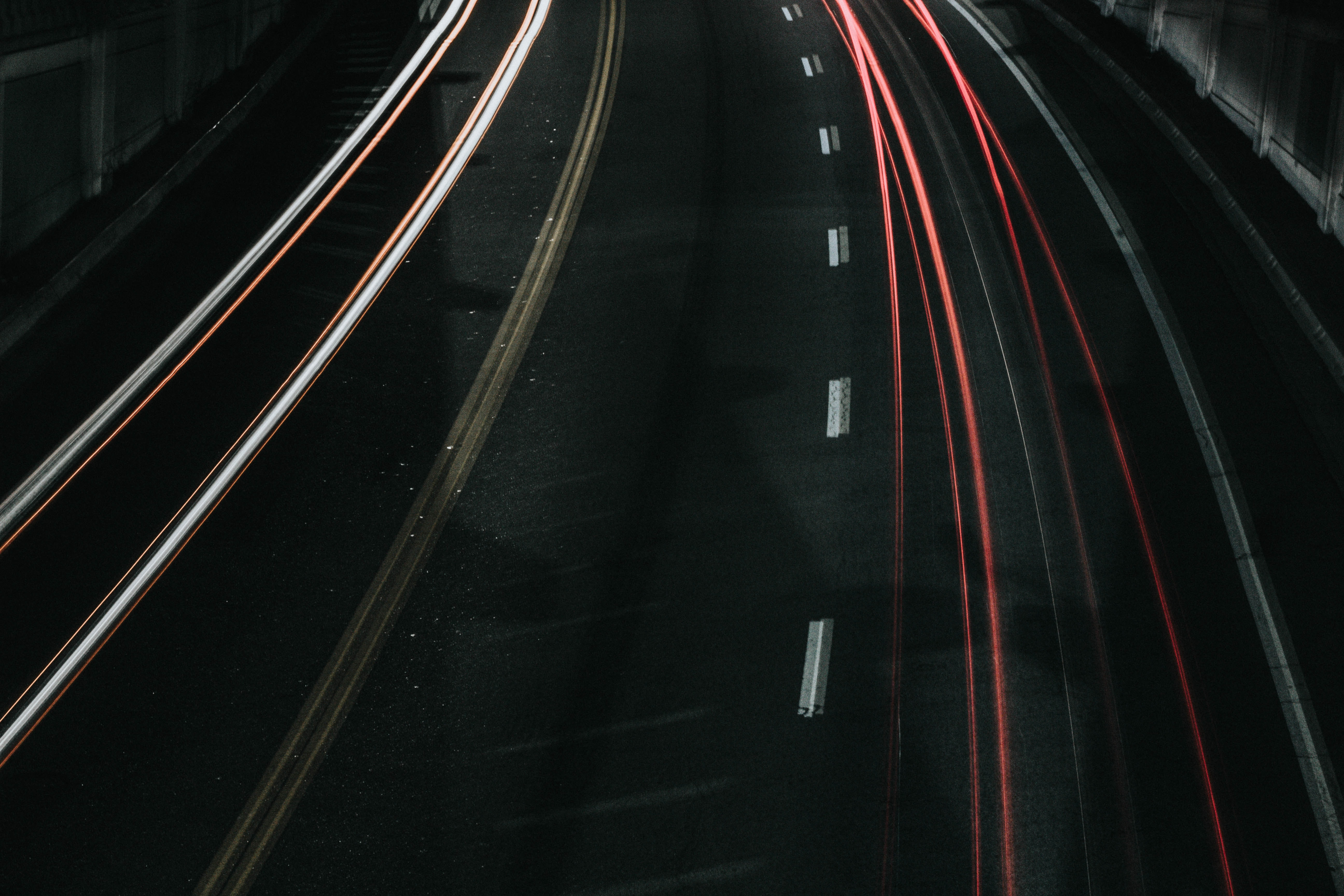 time lapse photo of vehicle passing through road
