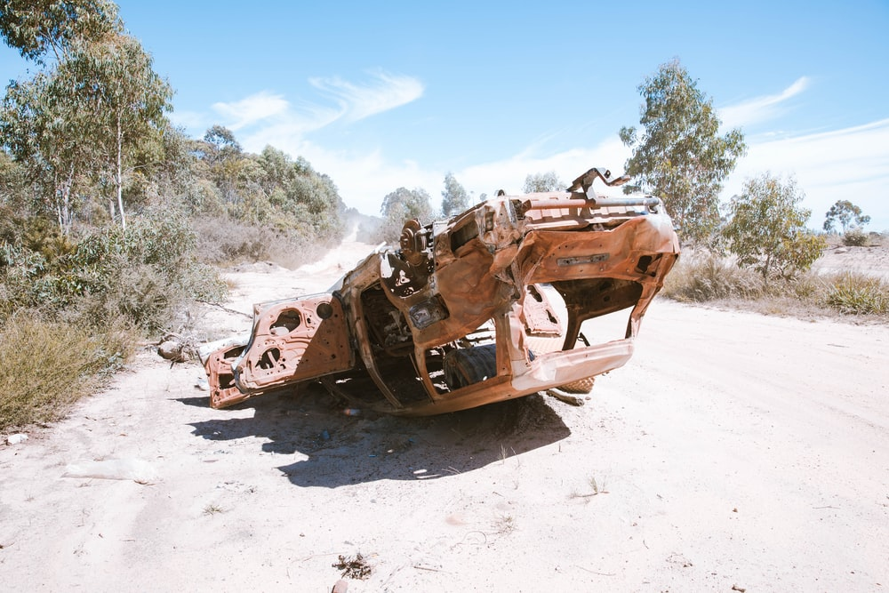 wrecked car on ground