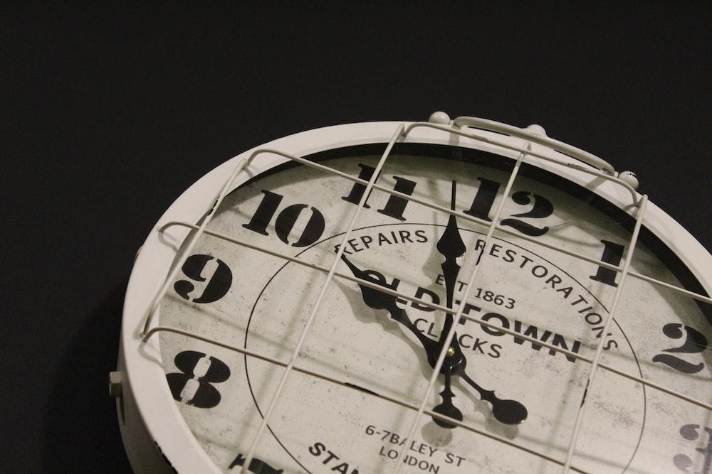 analog clock at 10:59