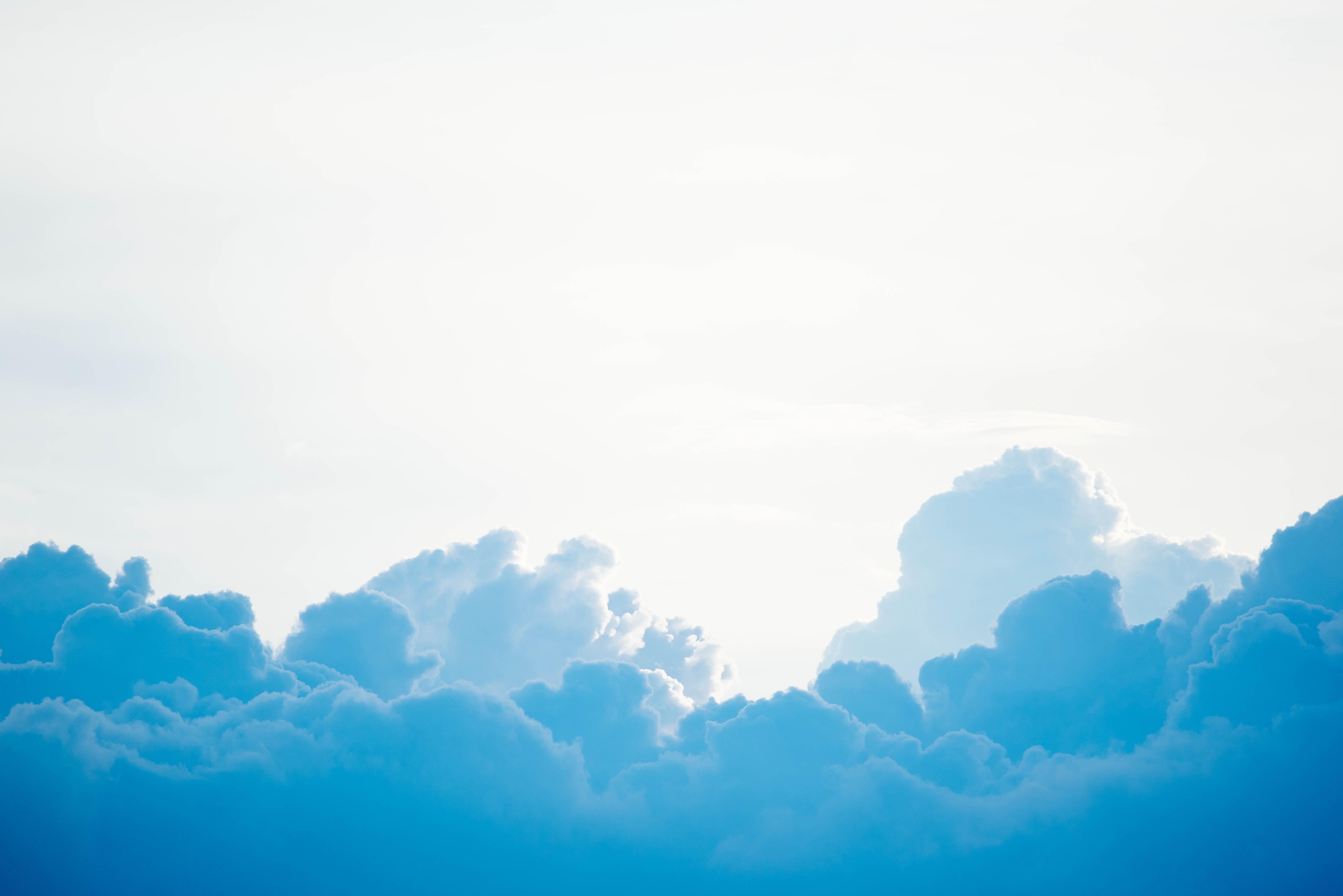 blue clouds under white sky