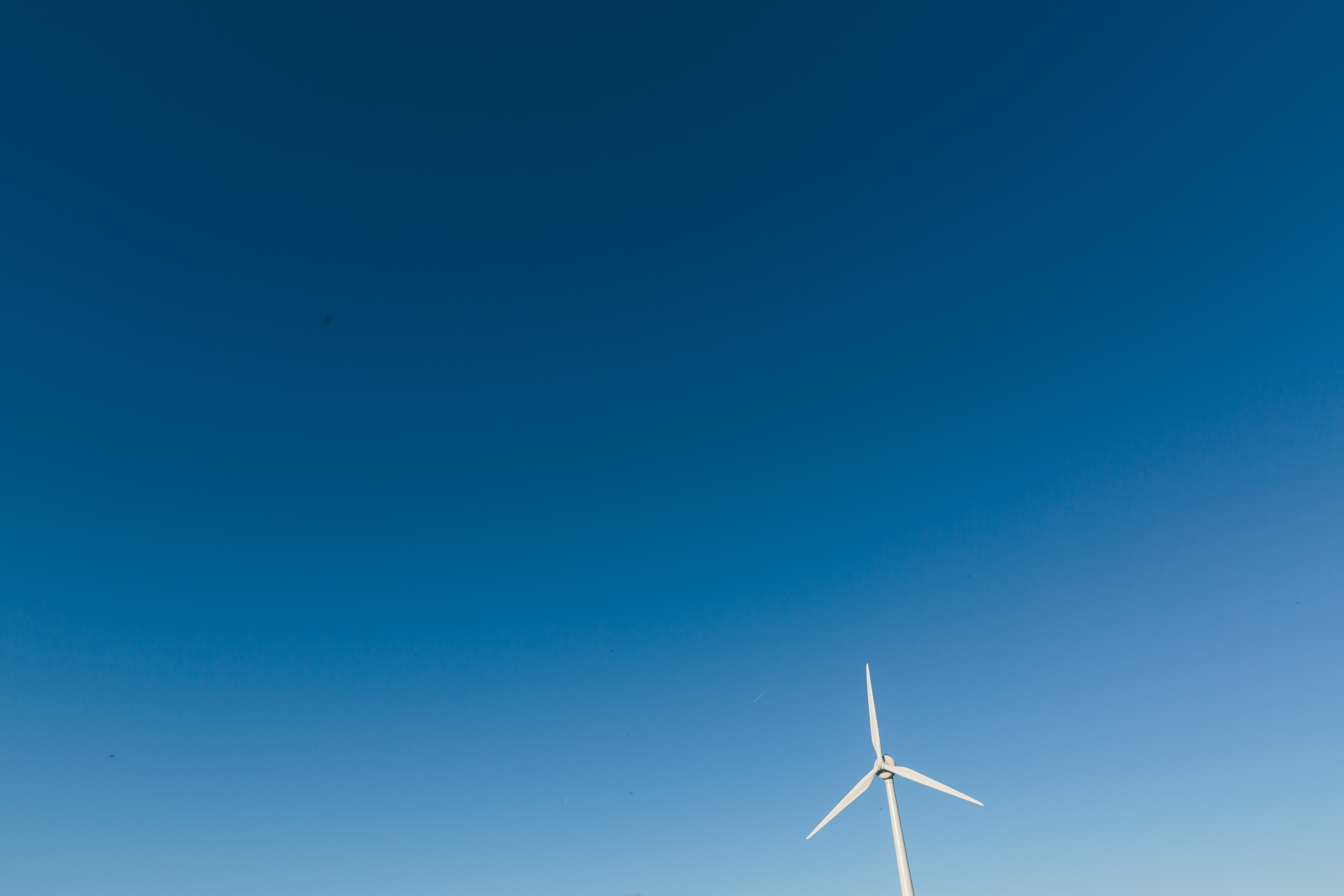 photo of white wind turbine during daytime