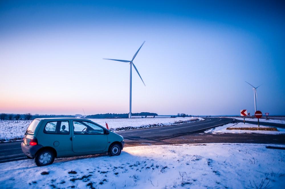 gray 3-door hatchback near windmills