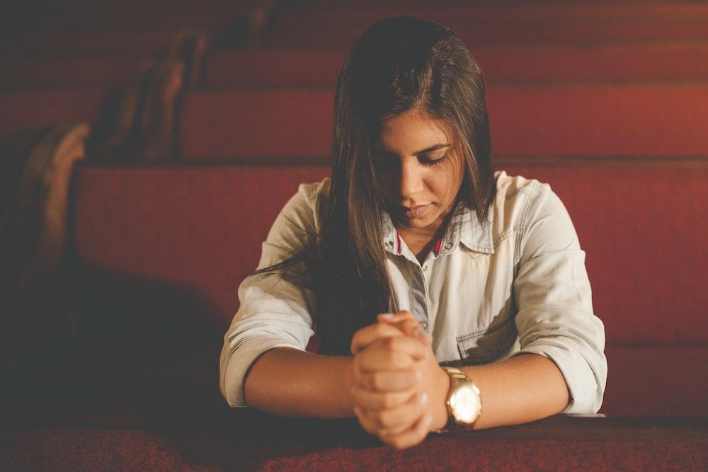 praying woman inside church