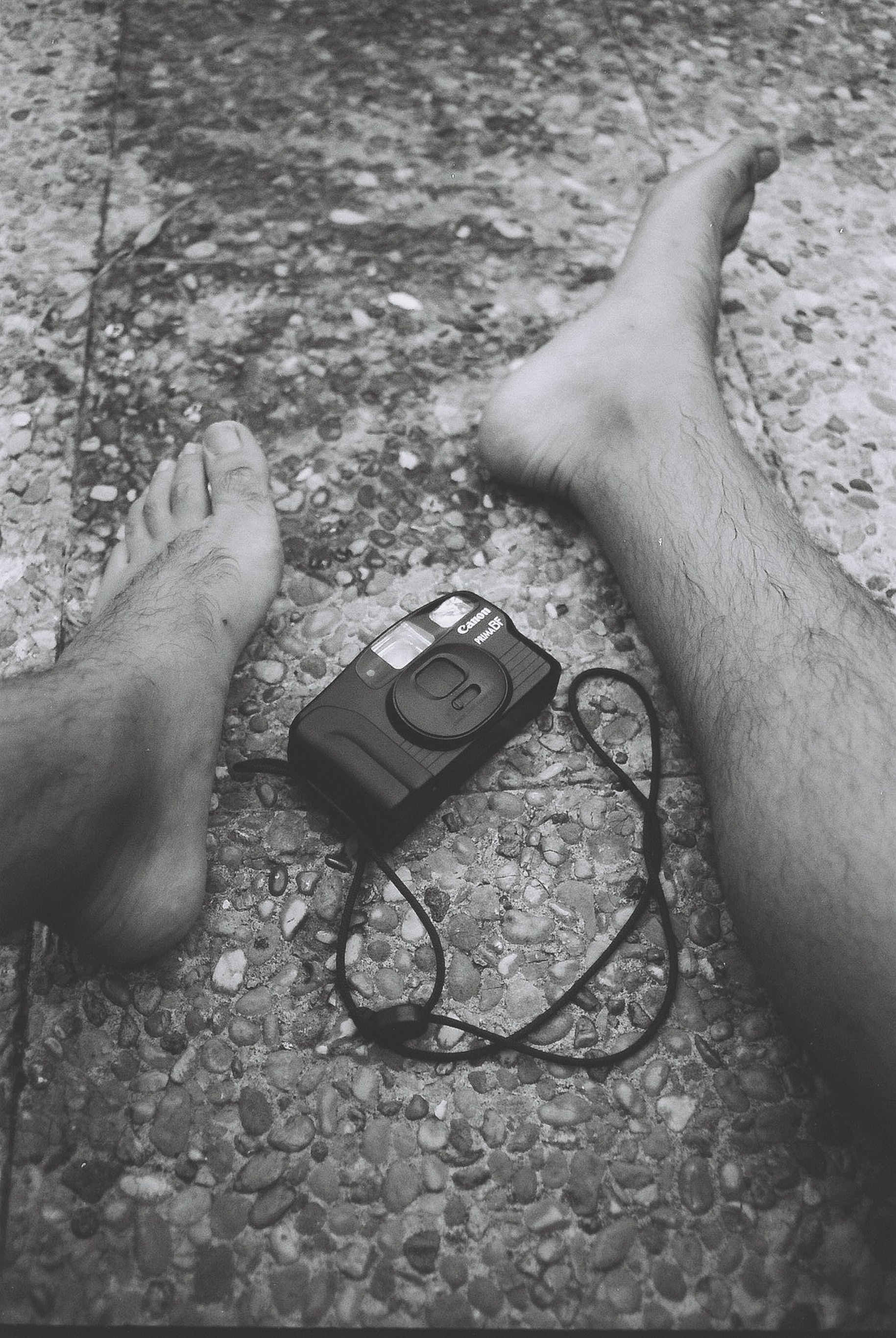 camera in the middle of persons feet