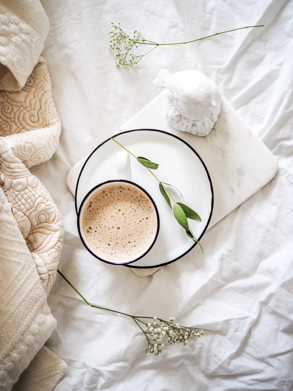 white teacup filled with coffee
