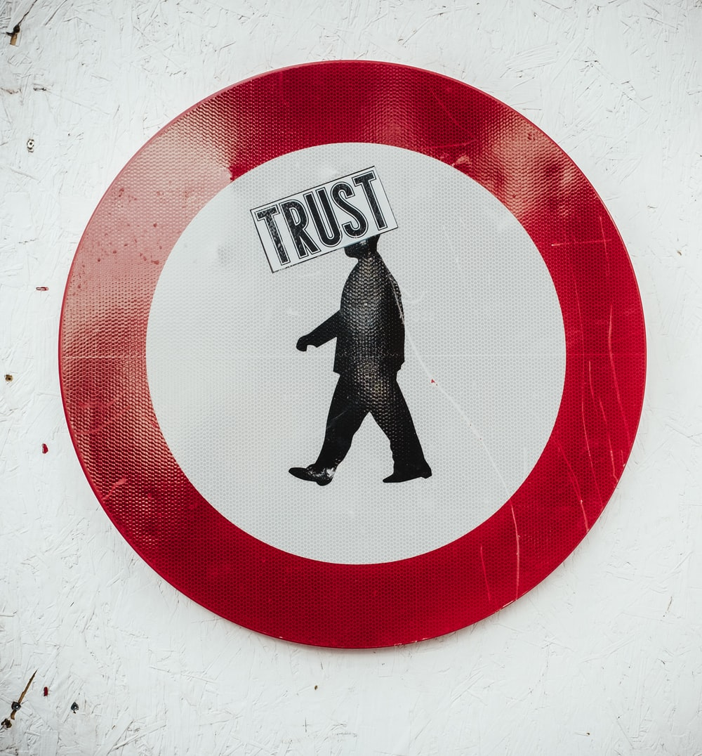 round red and white Trust signage
