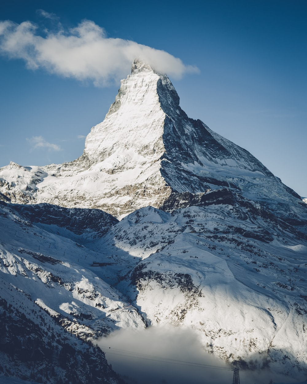 mountain covered by snow under blue sky
