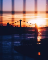 silhouette of Brooklyn and Manhattan Bridges during golden hour