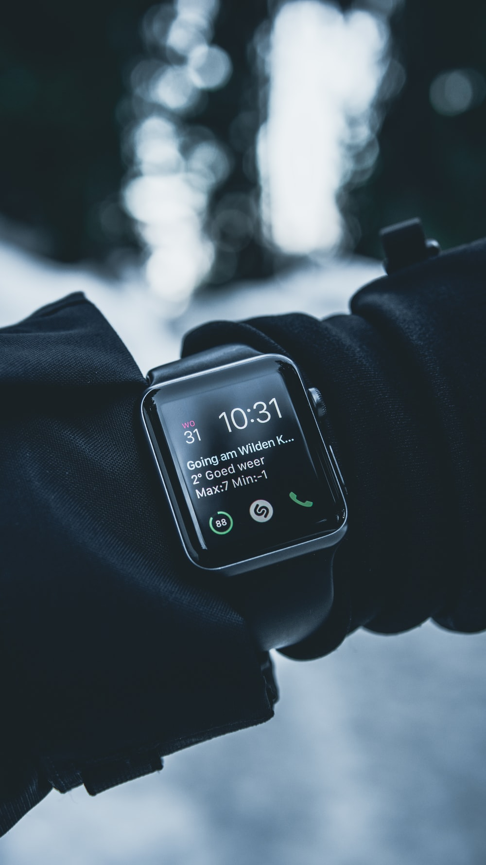 shallow focus photography of silver Apple Watch with black Sport Band