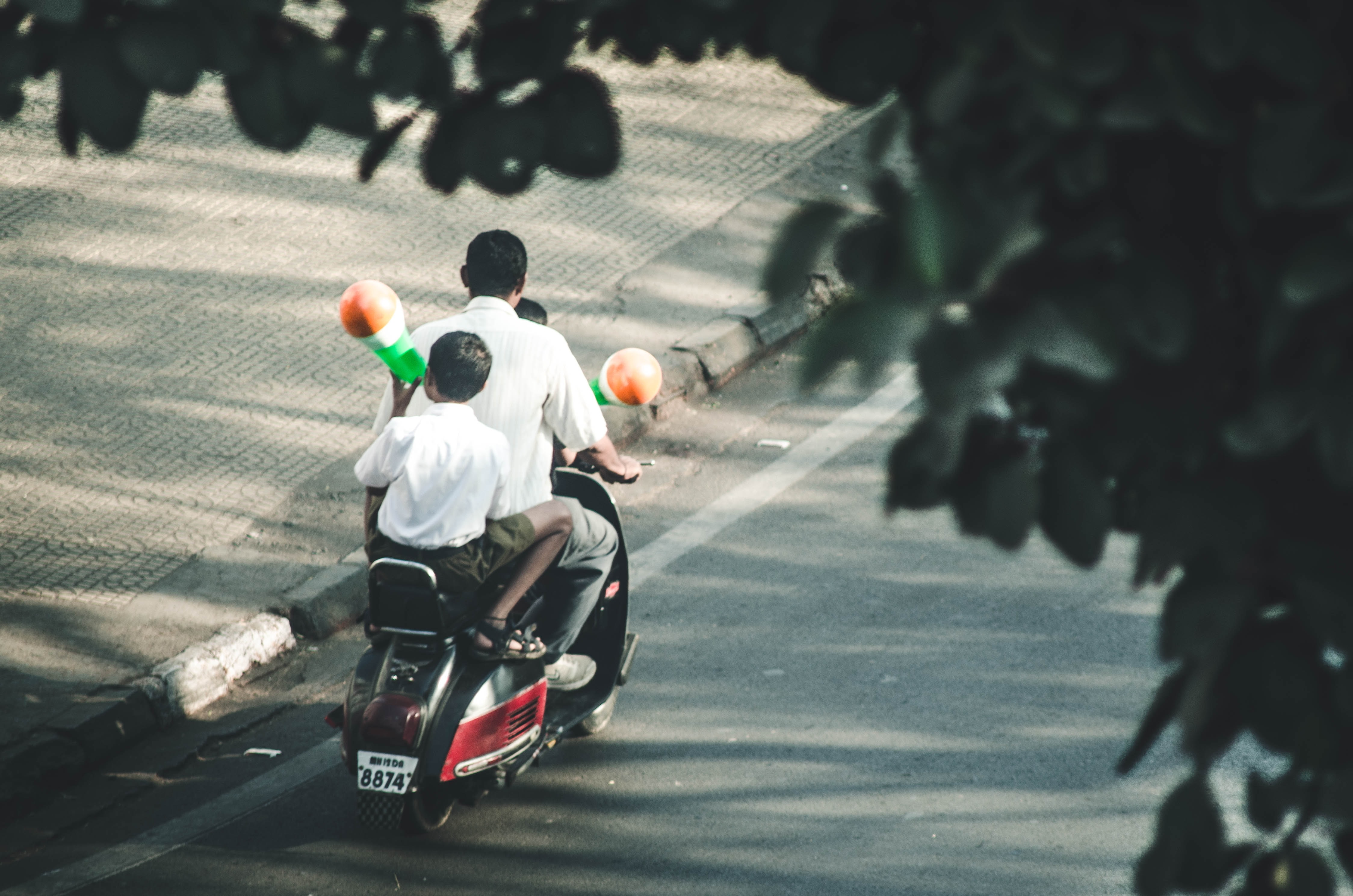 man and boys riding on motorcycle