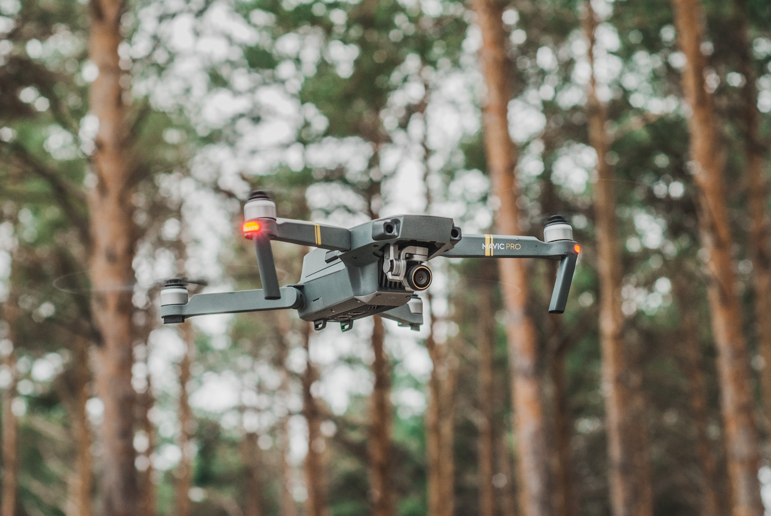 selective focus photography of quadcopter
