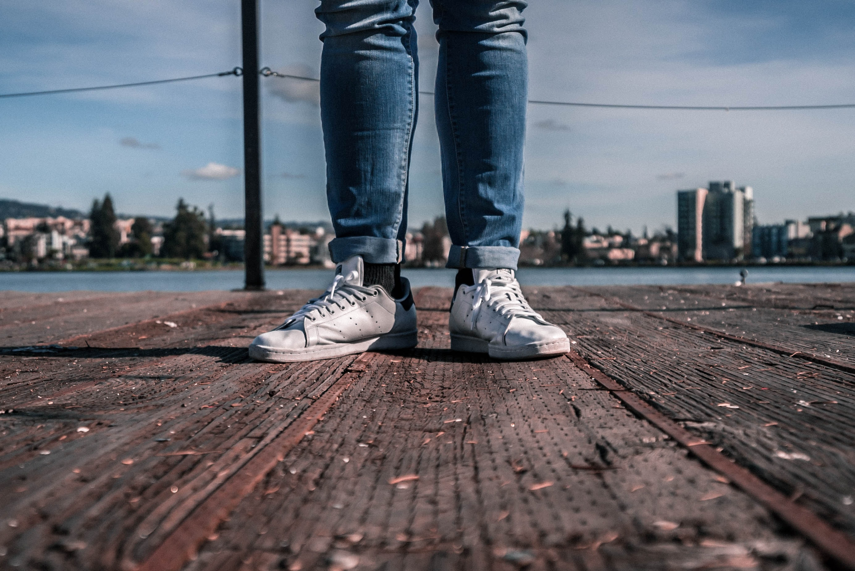 person wearing white low-top shoes