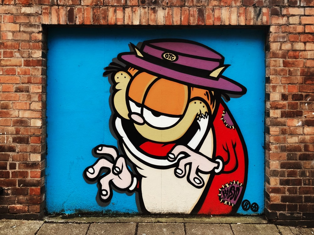 Garfield mural near brick wall