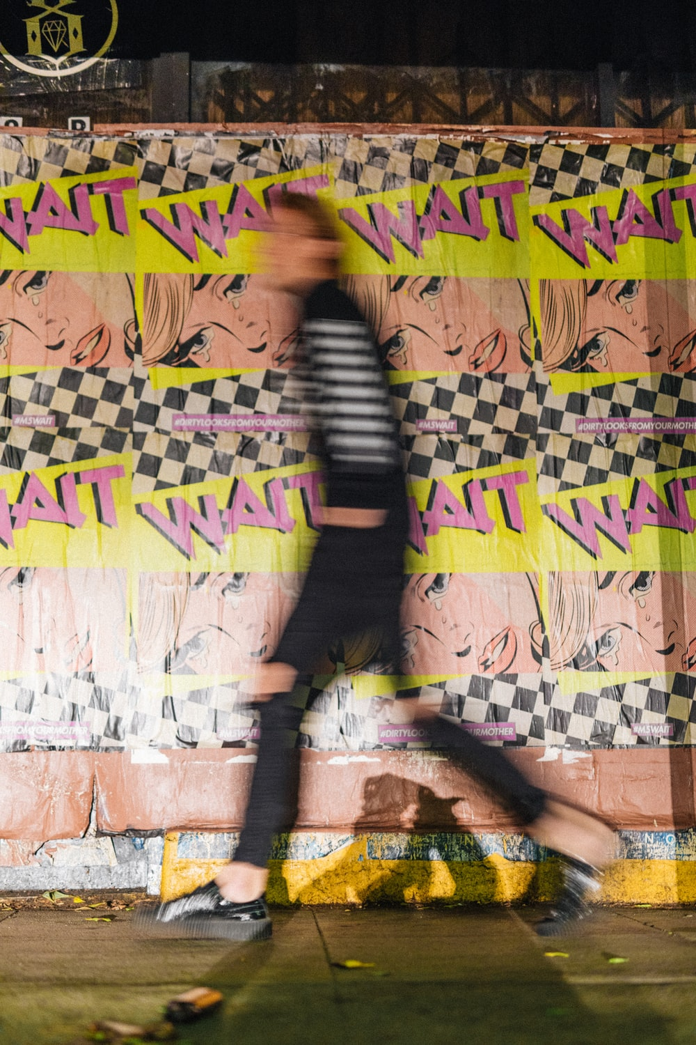 person passing by wait printed wall