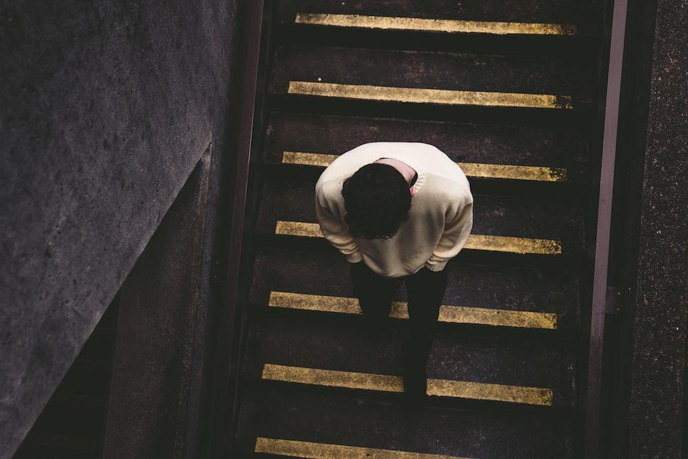 man walking on staircase