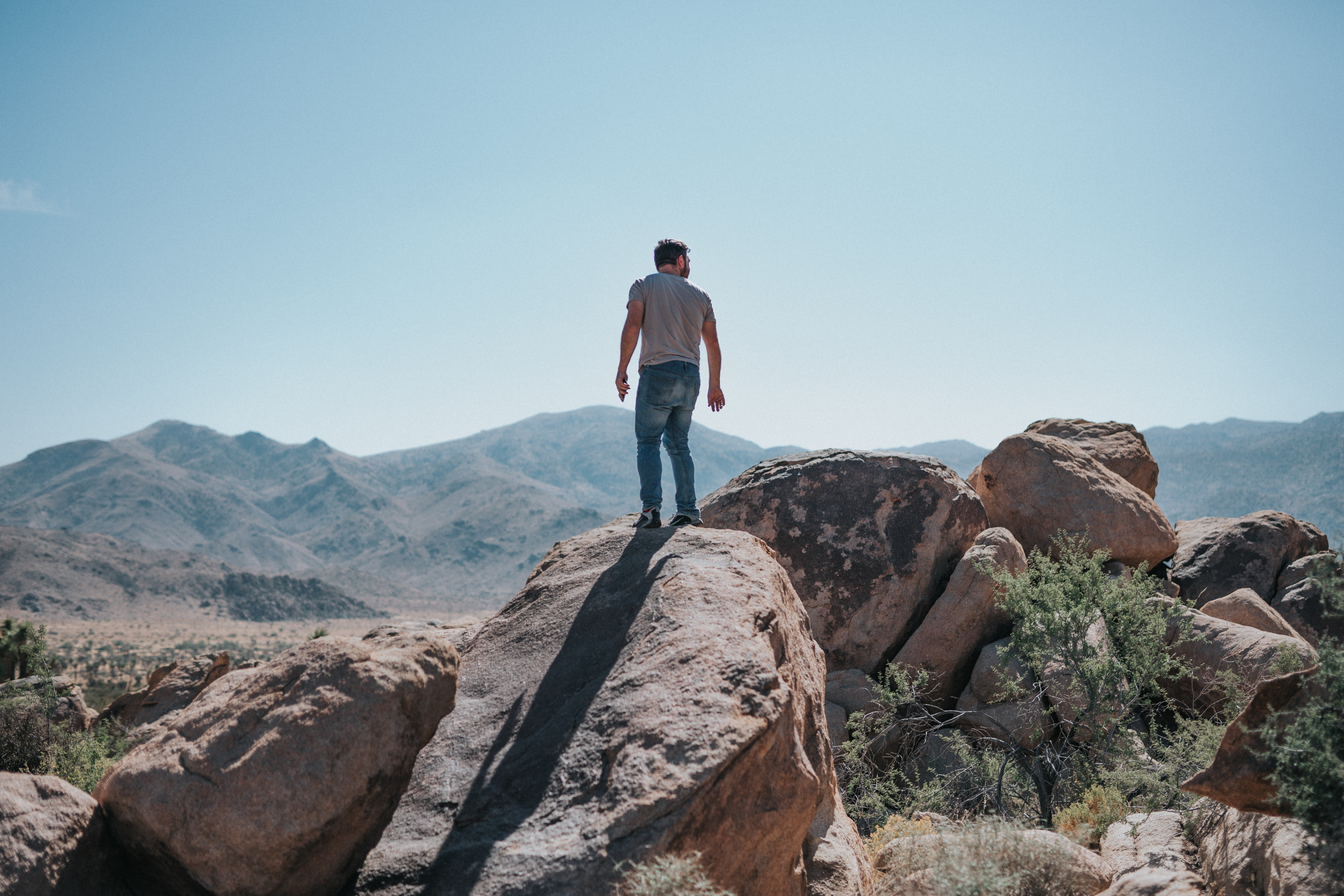 man standing on boulders