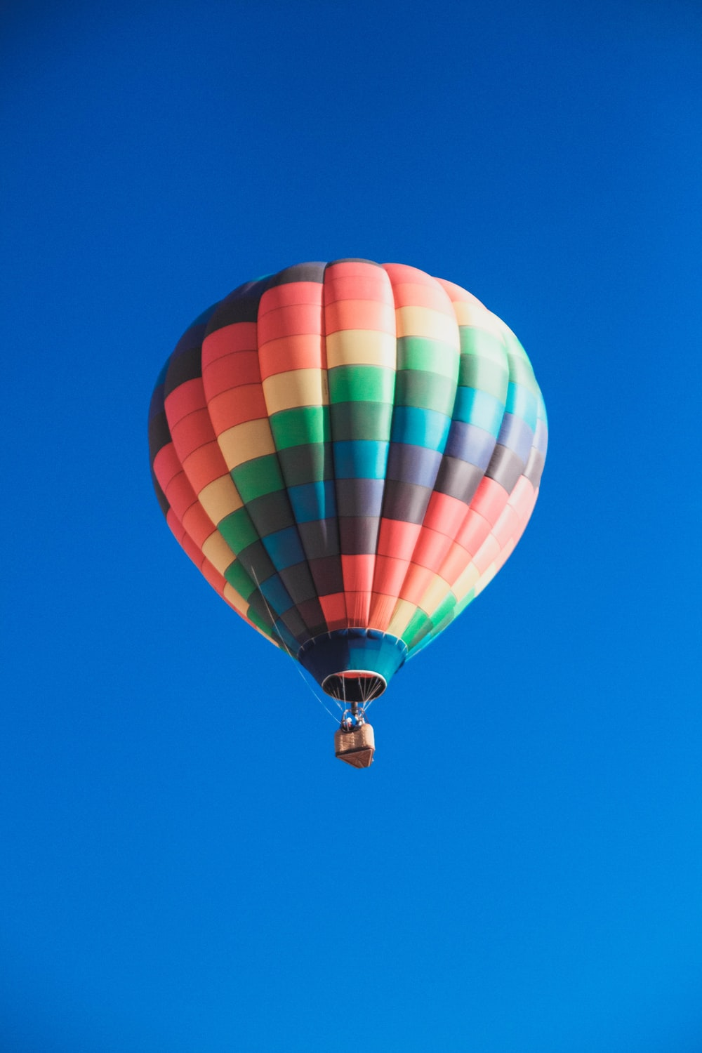 worm's eye view photography of multicolored hot air balloon
