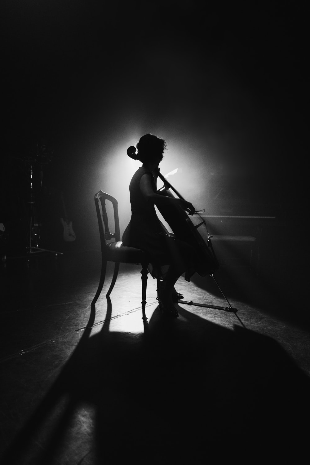grayscale photo of person playing music instrument