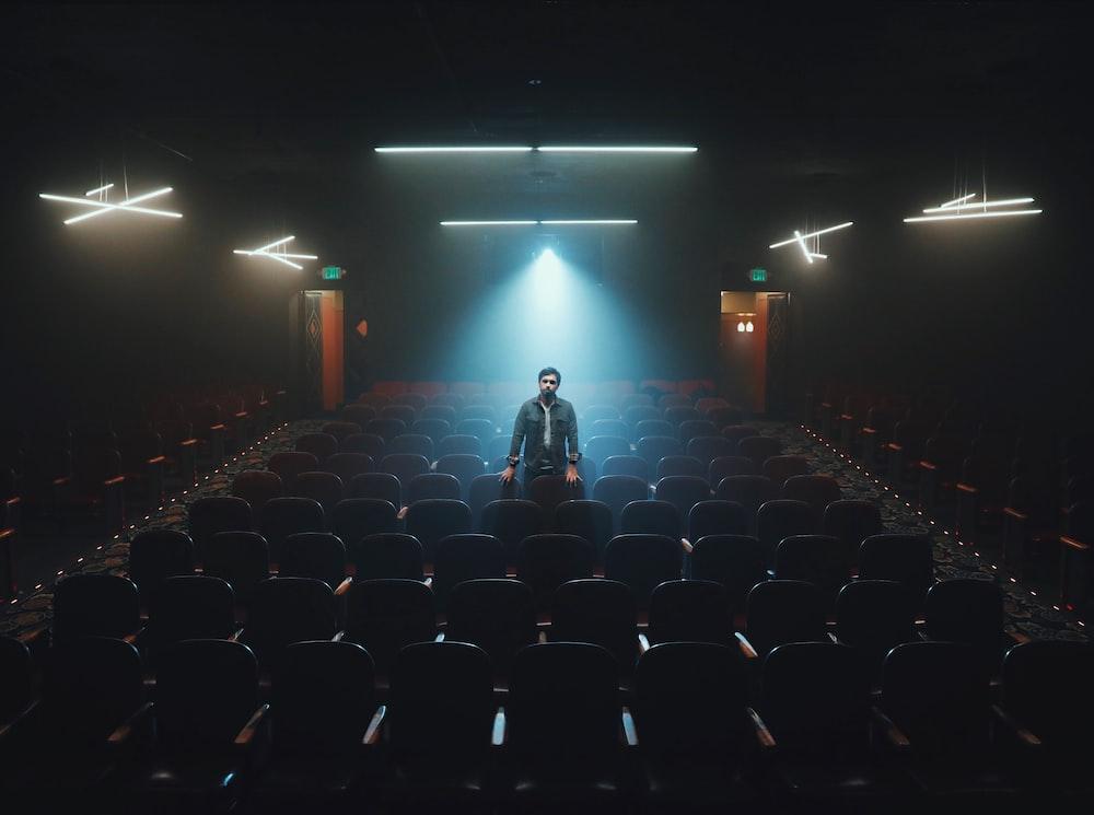man standing in cinema