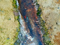 aerial photography of two person's riding on kayak on river at daytime