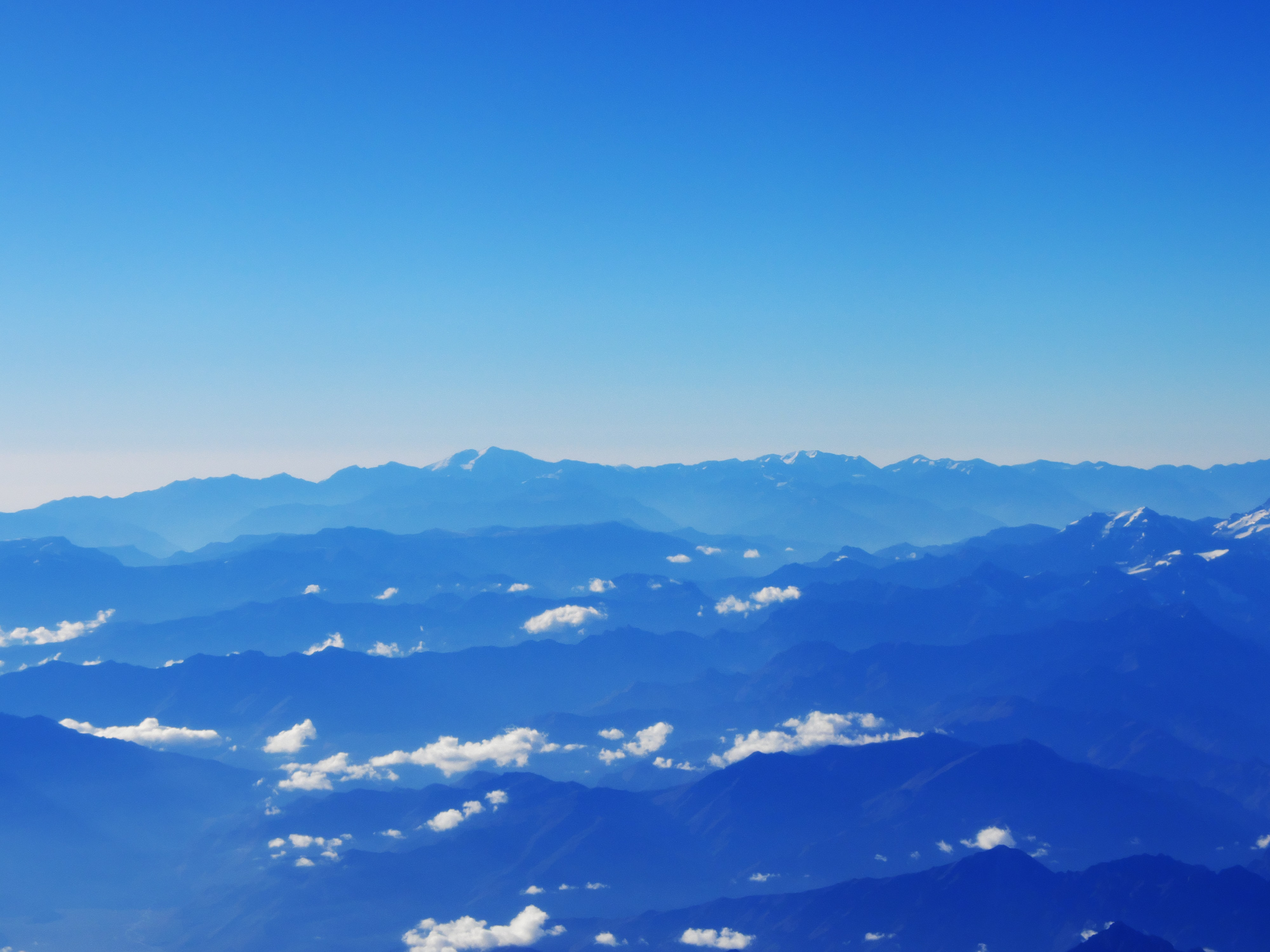 mountains under blue sky during daytime