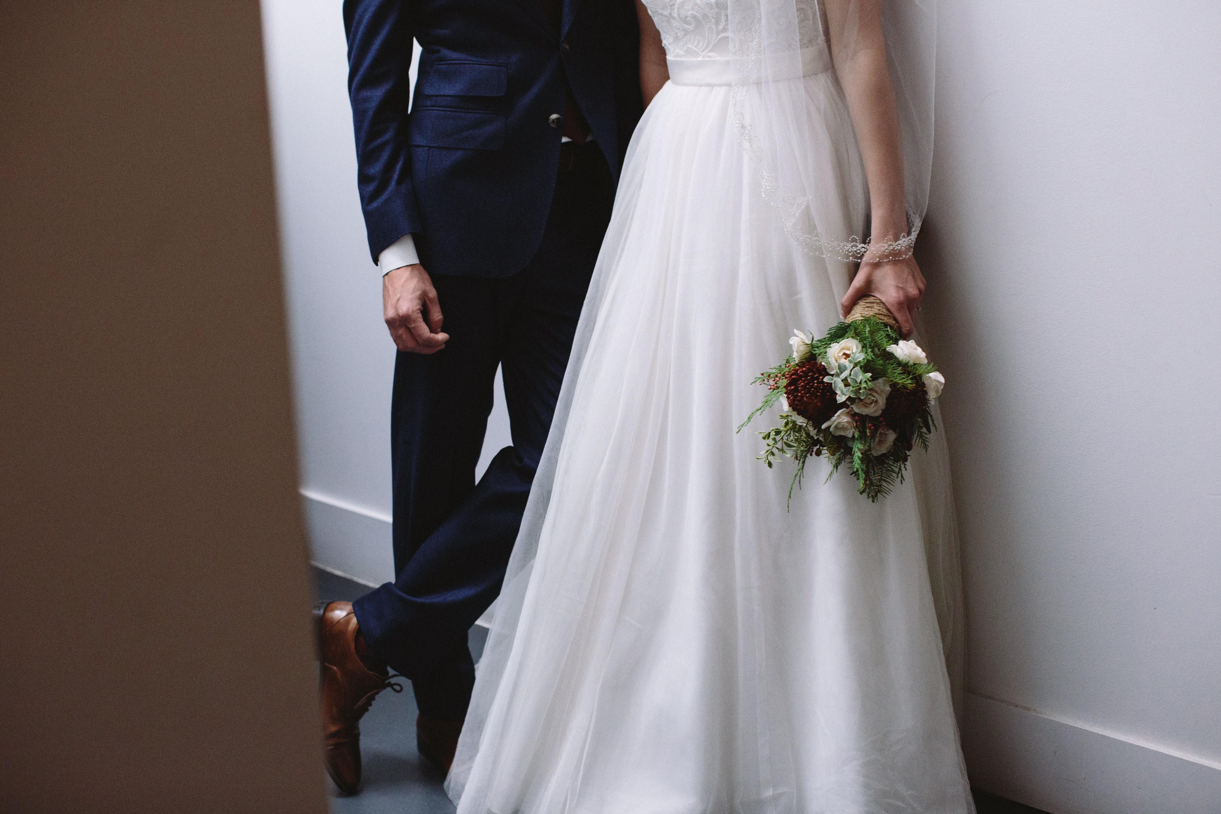women's white sleeveless wedding gown