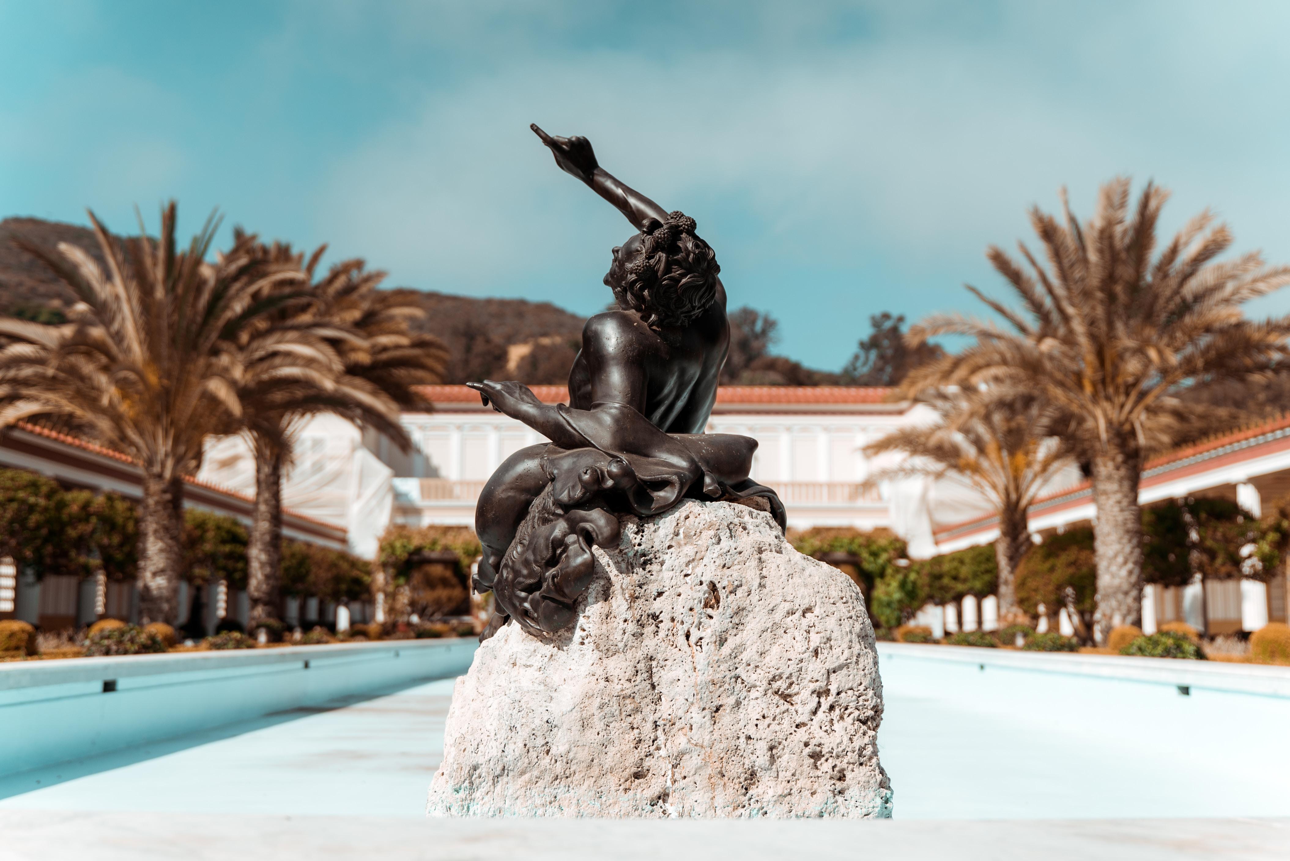 statue pointing upward