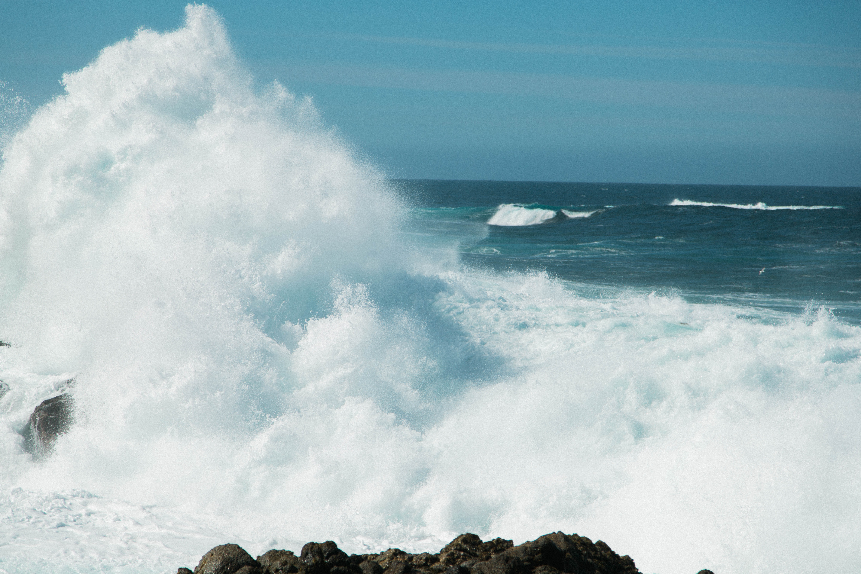 waving sea against rock